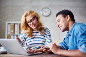 Woman and man consulting over computer
