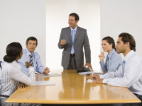 man presenting in board room